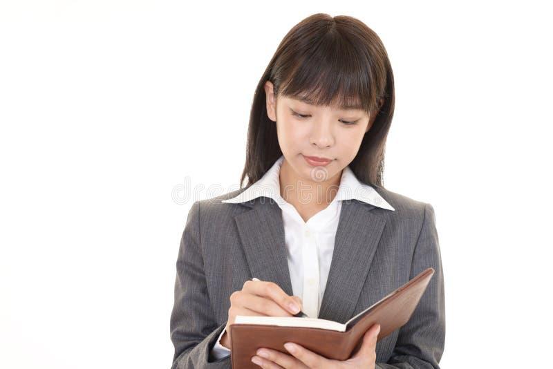Mujer de negocios asiática de trabajo imagenes de archivo