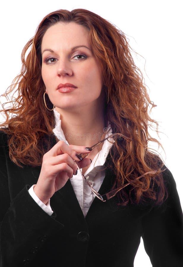 Mujer de negocios atractiva con el pelo rizado fotos de archivo libres de regalías
