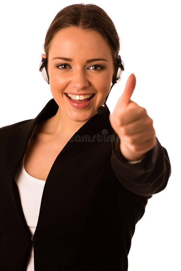Mujer de negocios caucásica asiática feliz de Preety con la demostración de las auriculares imagen de archivo