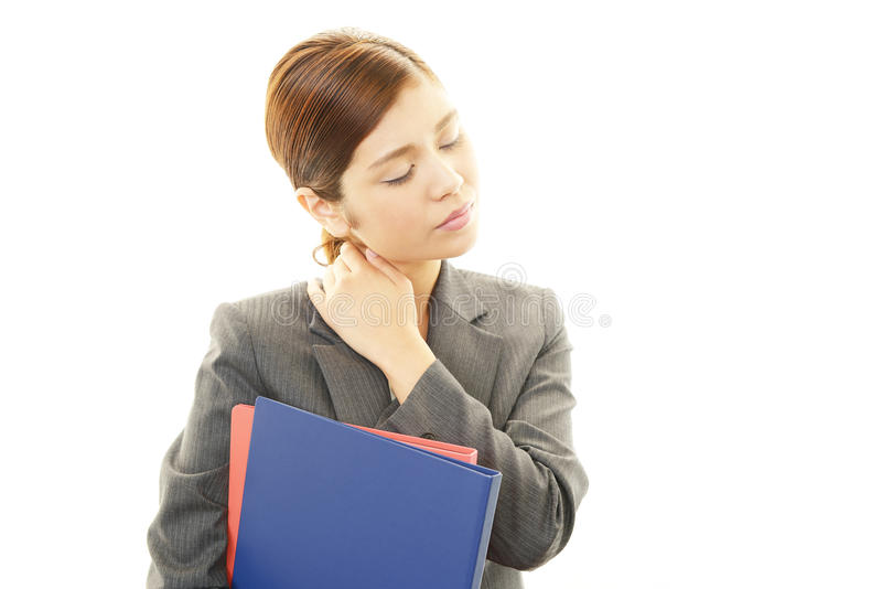 Mujer de negocios con dolor de cuello. foto de archivo libre de regalías