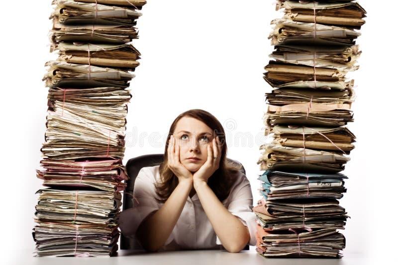 Mujer de negocios con exceso de trabajo foto de archivo