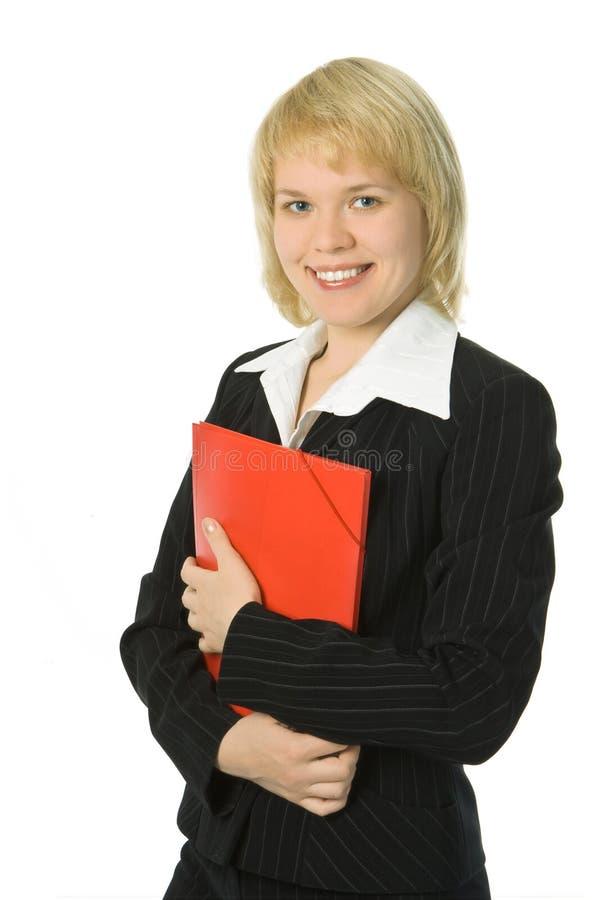 Mujer de negocios con la carpeta roja fotografía de archivo libre de regalías