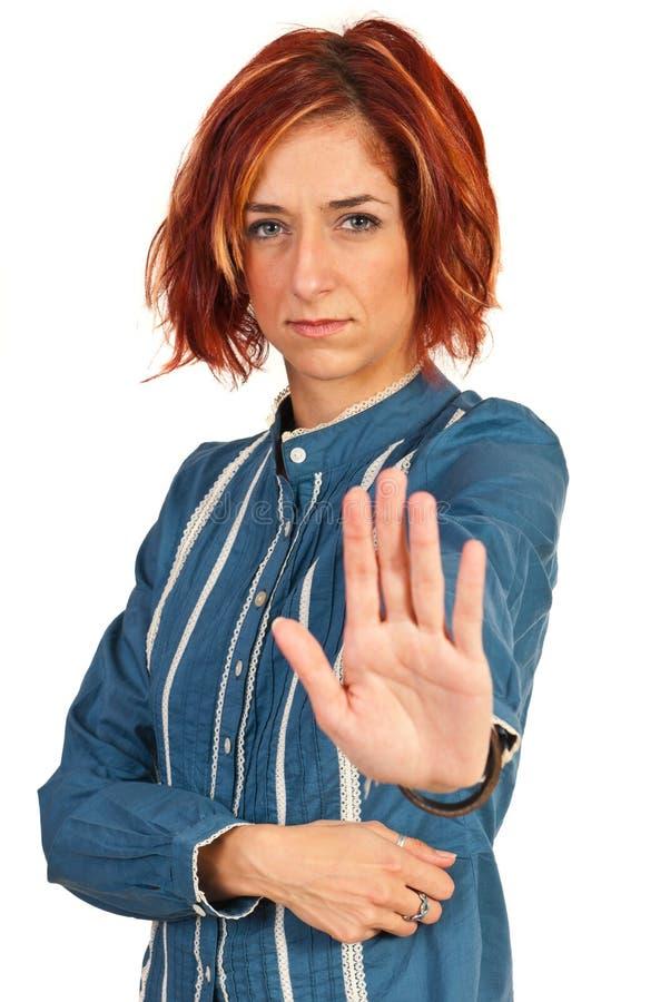 Mujer de negocios con la mano de la parada imagenes de archivo