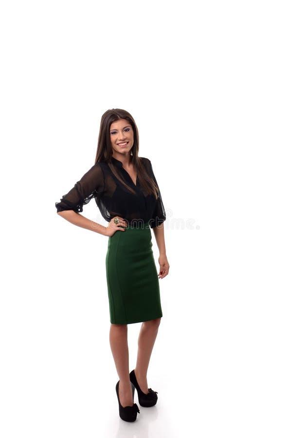 Mujer de negocios con la mano en la cintura en actitud integral imágenes de archivo libres de regalías