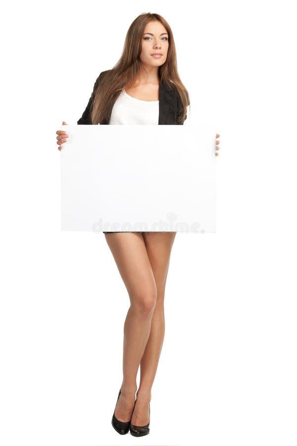 Mujer de negocios con la tarjeta en blanco fotos de archivo