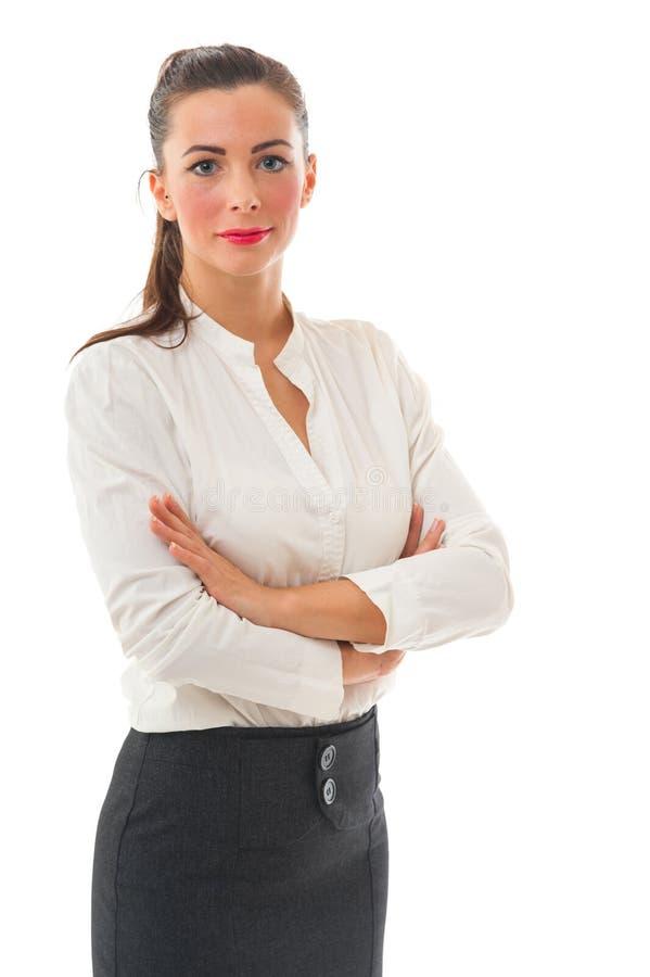 Mujer de negocios con los brazos cruzados en el fondo blanco foto de archivo