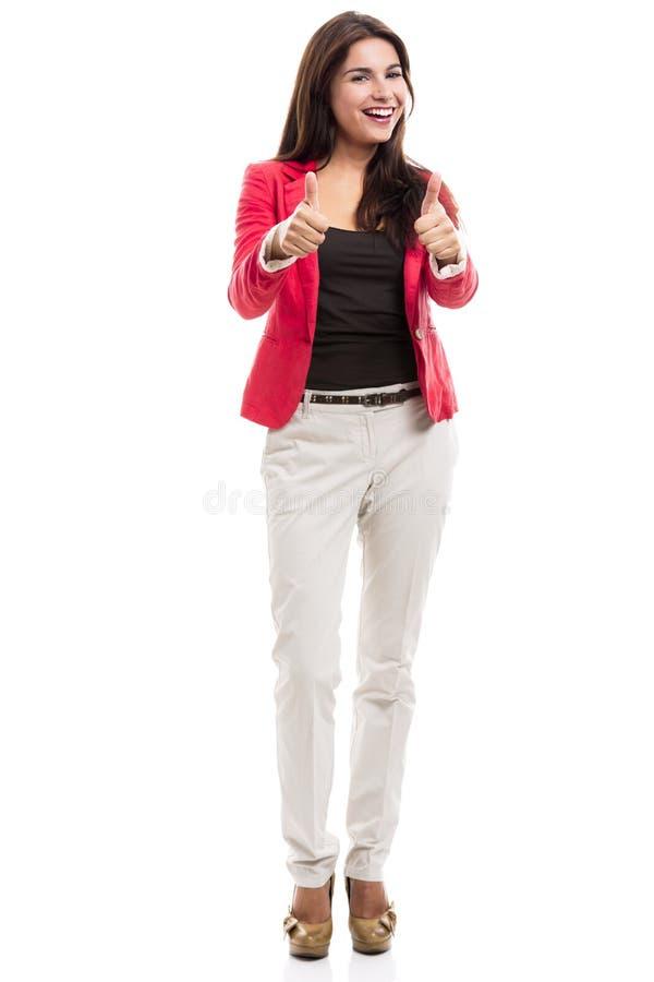 Mujer de negocios con los pulgares para arriba imagen de archivo