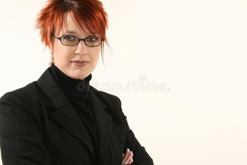 Mujer de negocios con los vidrios fotografía de archivo libre de regalías