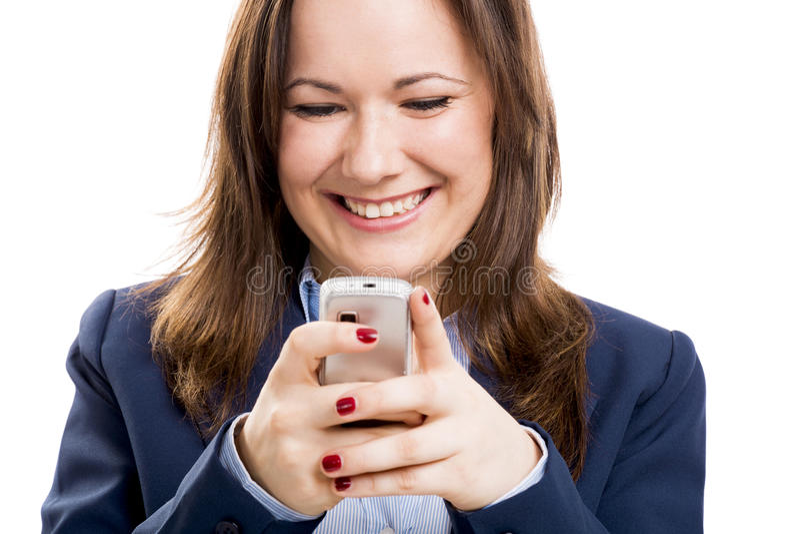 Mujer de negocios con mandar un SMS del teléfono móvil fotos de archivo