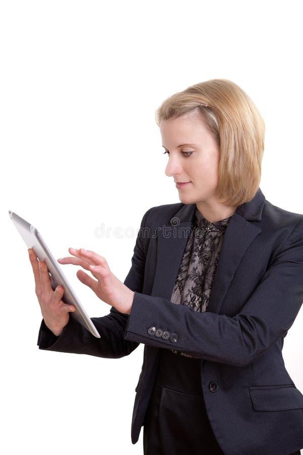 Mujer de negocios con PC de la tablilla fotos de archivo libres de regalías