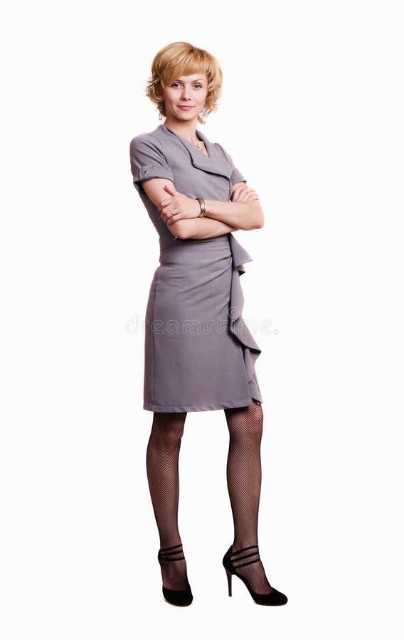 Mujer de negocios confidente sobre blanco imagenes de archivo