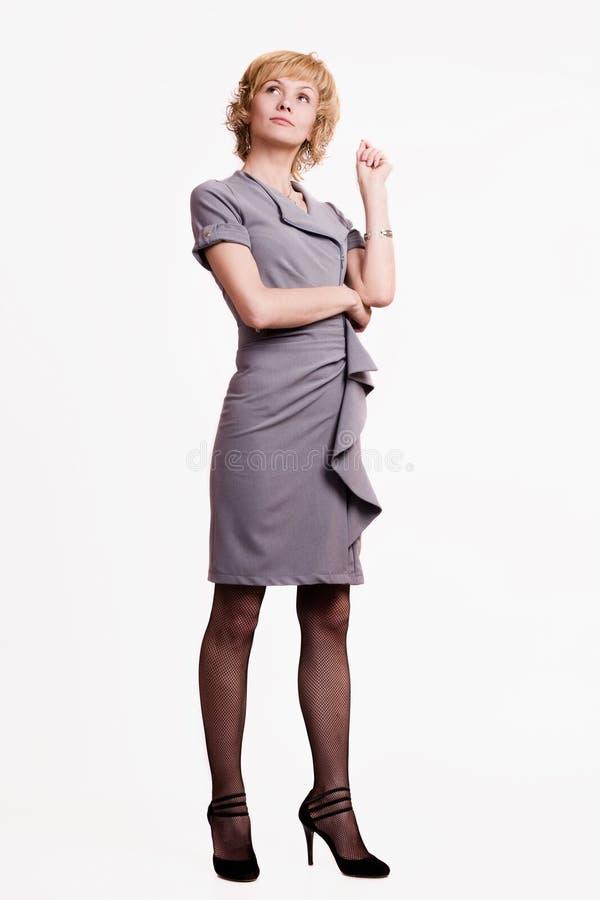 Mujer de negocios confidente sobre blanco imagen de archivo libre de regalías