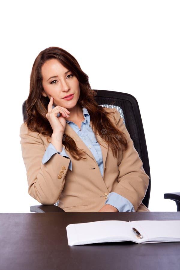 Mujer de negocios corporativos en el escritorio foto de archivo libre de regalías