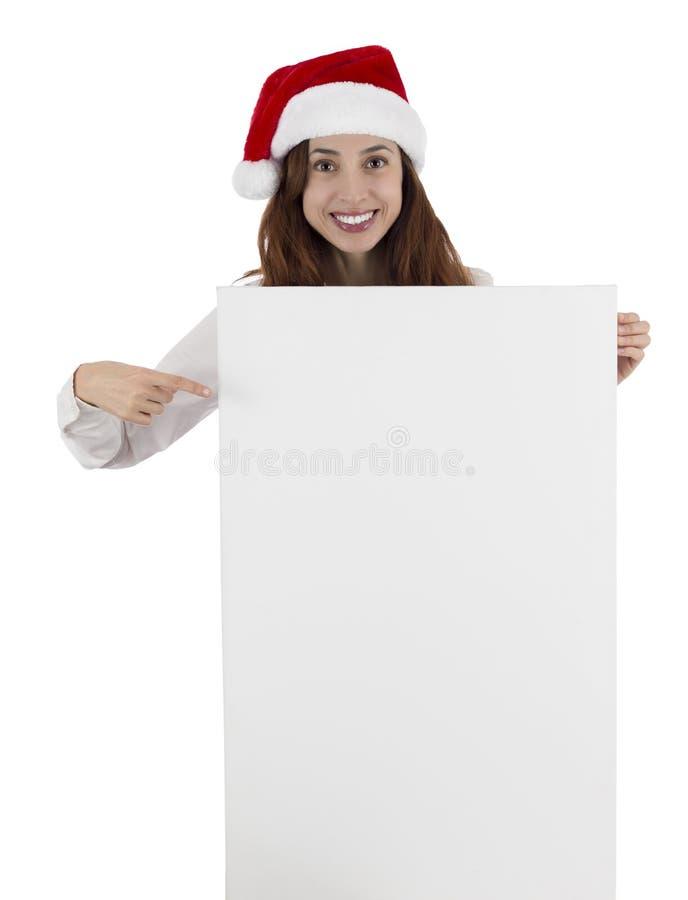 Mujer de negocios de la Navidad que señala al espacio de la copia foto de archivo