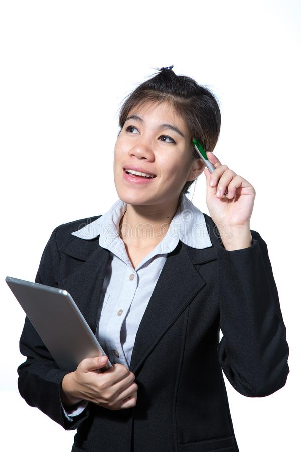 Mujer de negocios elegante confiada, sonriente, concepto usando la tableta del ordenador foto de archivo libre de regalías