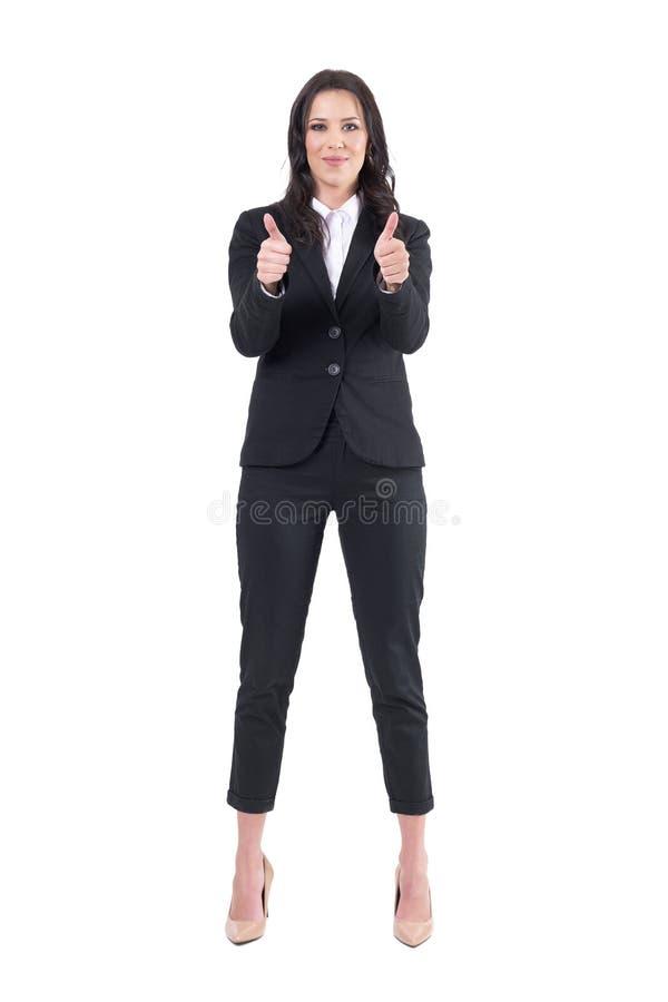 Mujer de negocios elegante hermosa feliz satisfecha que muestra los pulgares encima del gesto en la cámara fotografía de archivo libre de regalías