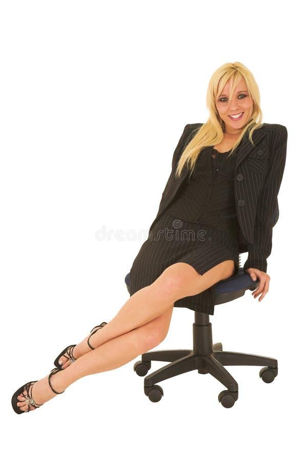 Mujer de negocios en #125 rojo imagen de archivo