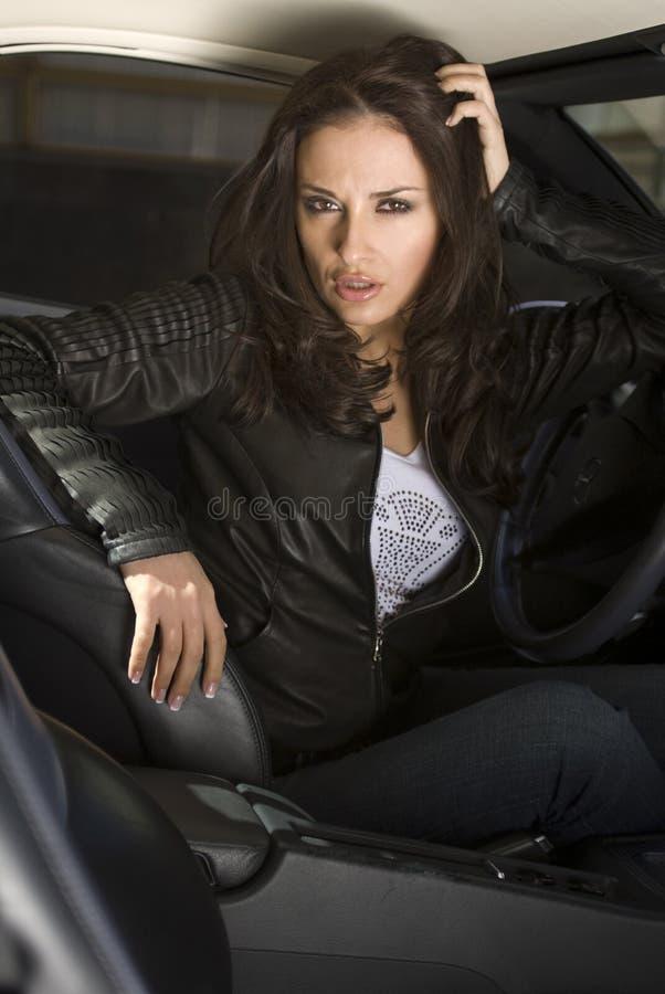 Mujer de negocios en el coche fotografía de archivo libre de regalías