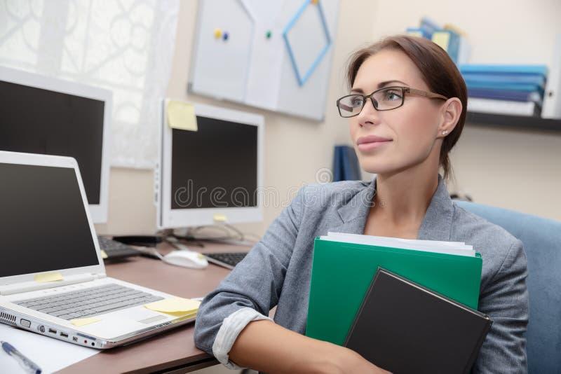 Mujer de negocios en el trabajo fotografía de archivo