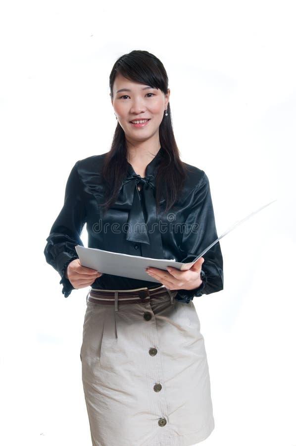 Mujer de negocios en un blanco fotografía de archivo libre de regalías