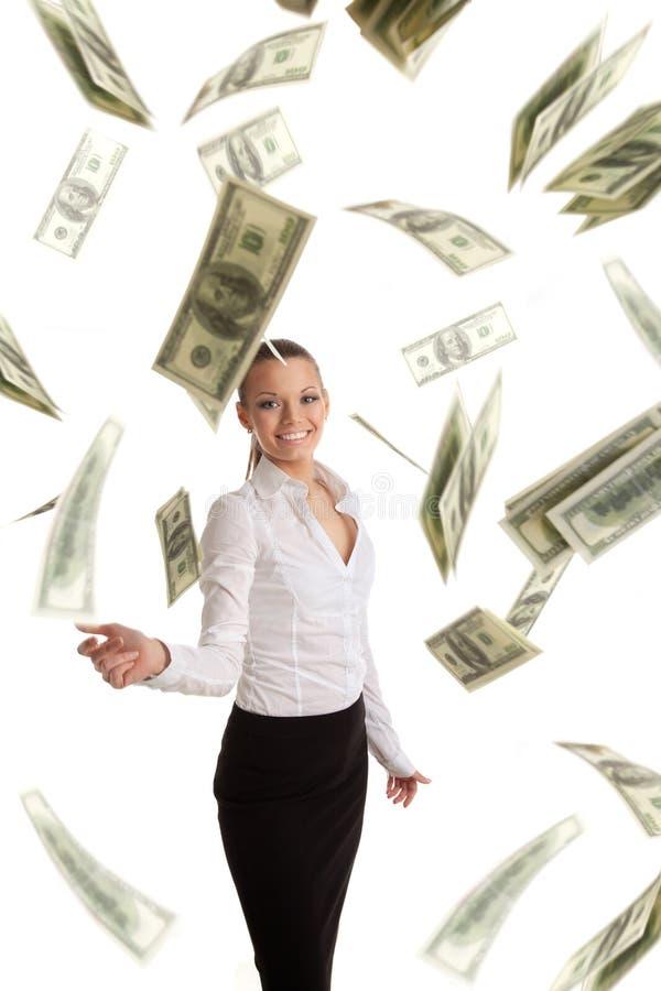 Mujer de negocios feliz en porciones del vuelo de dinero fotos de archivo libres de regalías