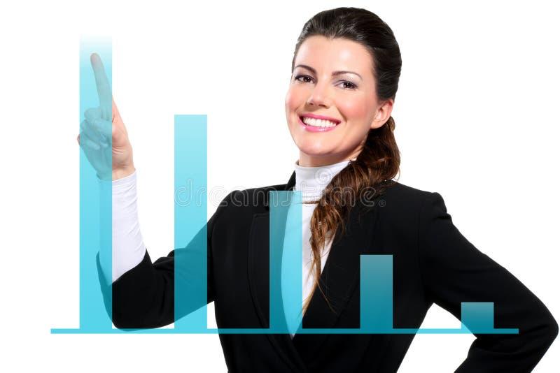 Mujer de negocios feliz hermosa joven que muestra cartas digitales foto de archivo libre de regalías