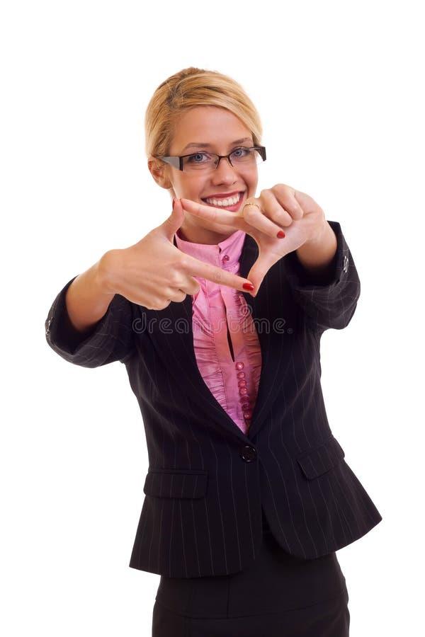 Mujer de negocios feliz que hace el marco de la mano imagen de archivo libre de regalías