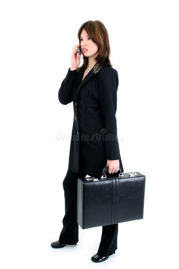 Mujer de negocios hermosa en el teléfono celular foto de archivo