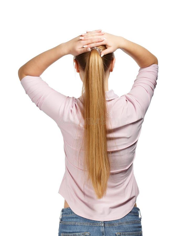 Mujer de negocios joven en la opinión blanca de la parte posterior del fondo imagenes de archivo
