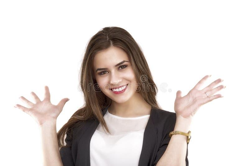 Mujer de negocios joven feliz que muestra el espacio de la copia en su palma fotos de archivo libres de regalías