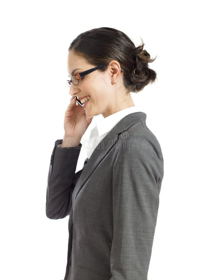 Mujer de negocios joven que habla en el teléfono 2 fotos de archivo