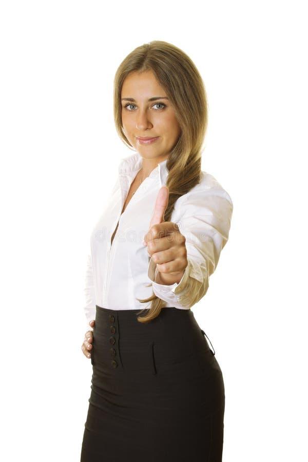 Mujer de negocios joven que muestra el pulgar para arriba fotografía de archivo libre de regalías