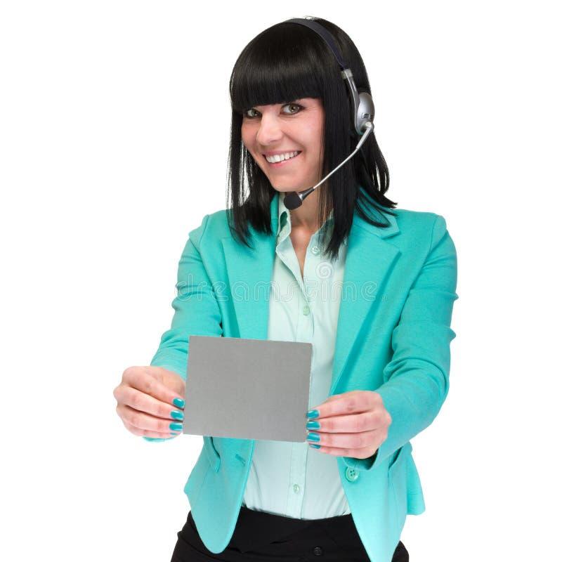 Mujer de negocios joven sonriente feliz que muestra el letrero en blanco imagen de archivo libre de regalías