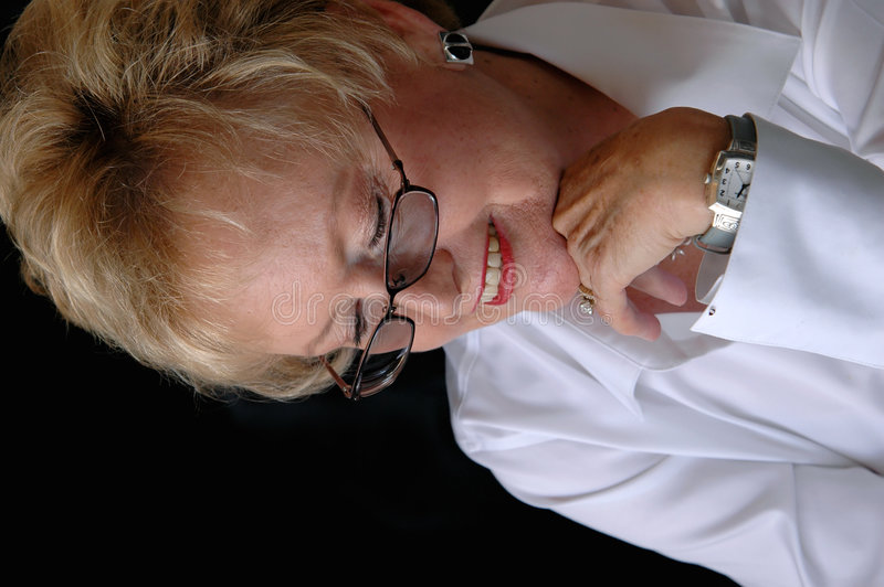 Mujer de negocios mayor con los vidrios imagenes de archivo