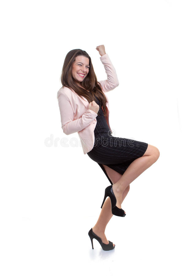 Mujer de negocios que celebra la promoción foto de archivo