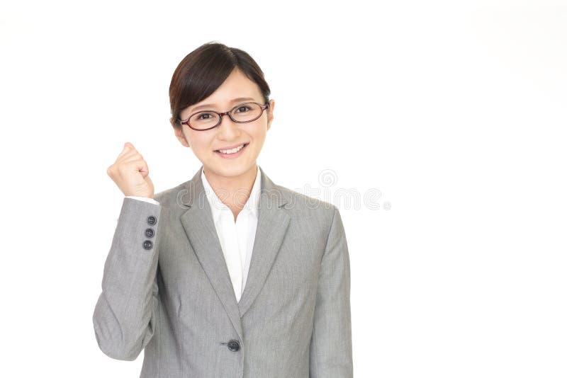 Mujer de negocios que disfruta de éxito imagen de archivo