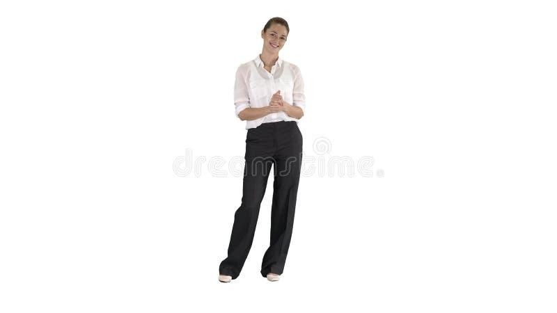 Mujer de negocios que habla con la cámara en el fondo blanco foto de archivo