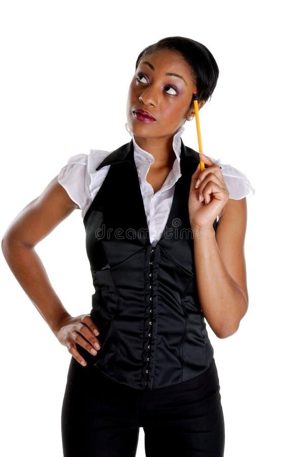 Mujer de negocios que piensa con un lápiz imágenes de archivo libres de regalías