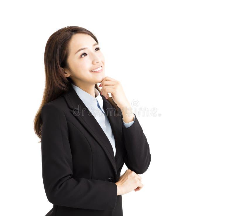 Mujer de negocios que piensa y que mira para arriba foto de archivo