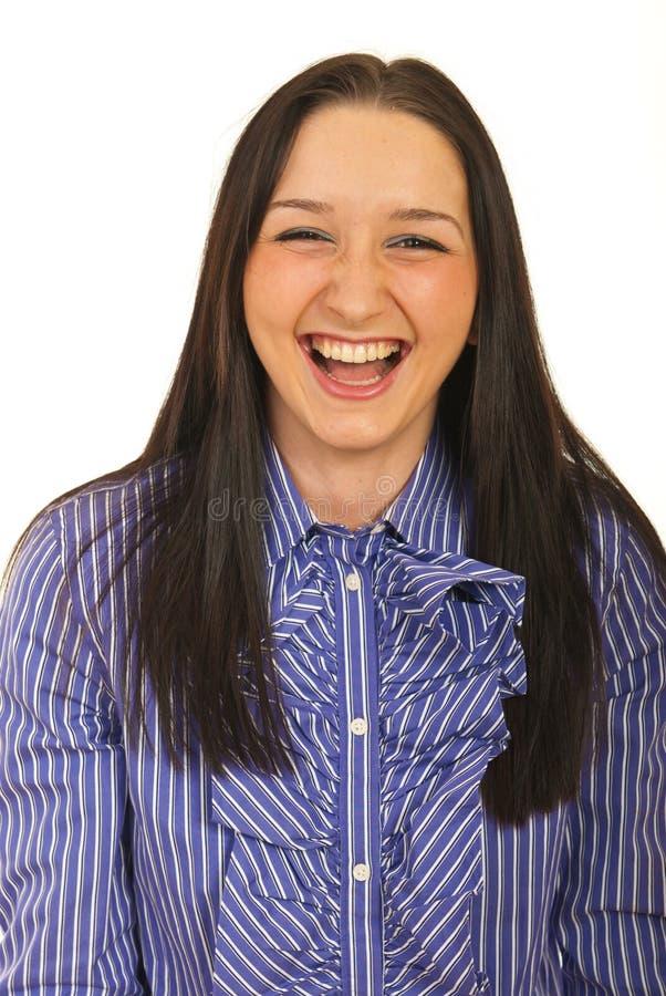 Mujer de negocios que ríe hacia fuera ruidosamente fotos de archivo