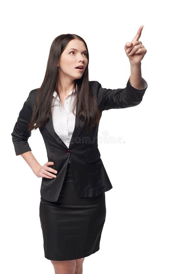 Mujer de negocios que señala en el espacio en blanco de la copia imágenes de archivo libres de regalías