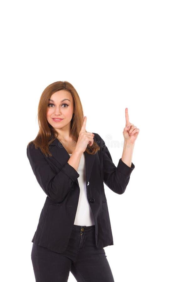 Mujer de negocios que señala en el espacio vacío. imagenes de archivo