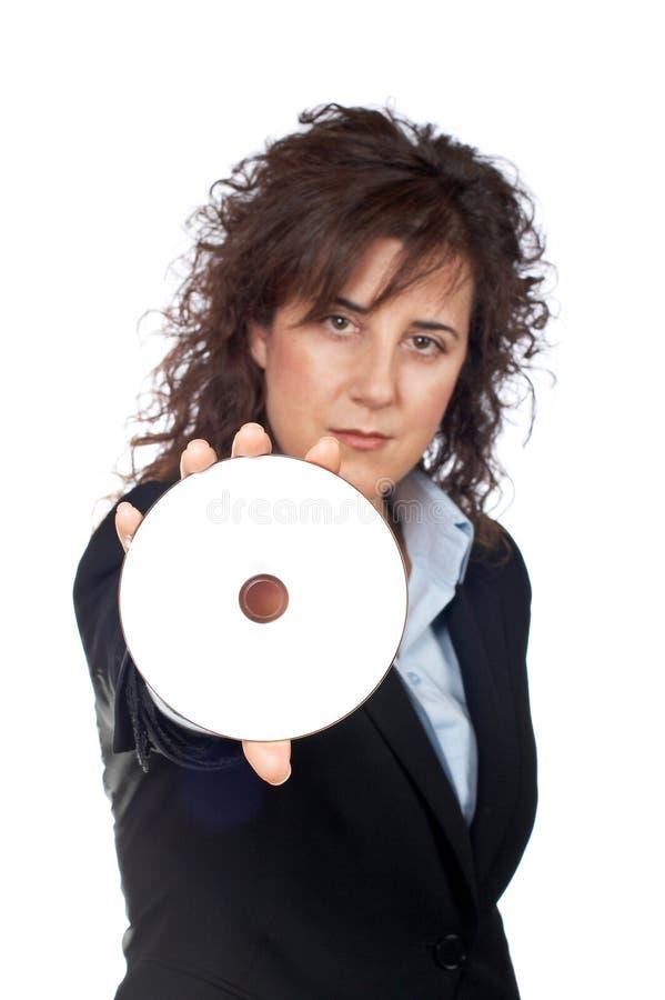 Mujer de negocios que sostiene un disco del dvd imagen de archivo libre de regalías