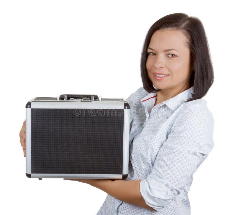 Mujer de negocios que sostiene una cartera de aluminio con la combinación Lo imagen de archivo