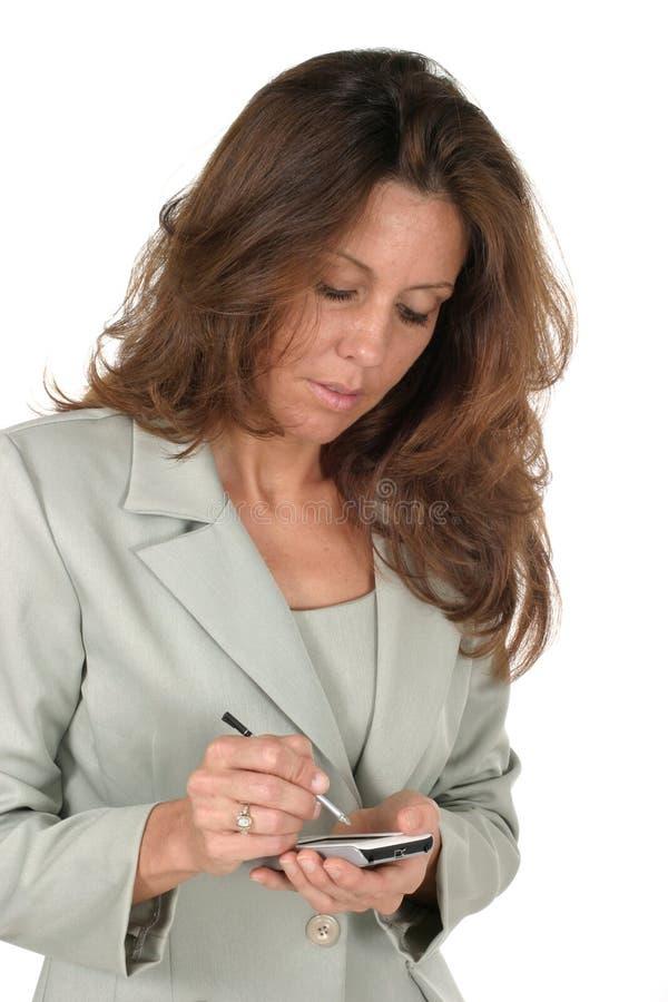 Mujer de negocios que usa PDA 1 fotografía de archivo