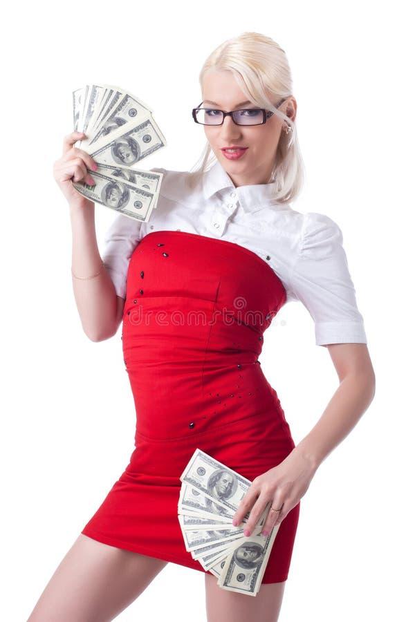 Mujer de negocios rubia atractiva en dólares rojos de la oferta fotografía de archivo