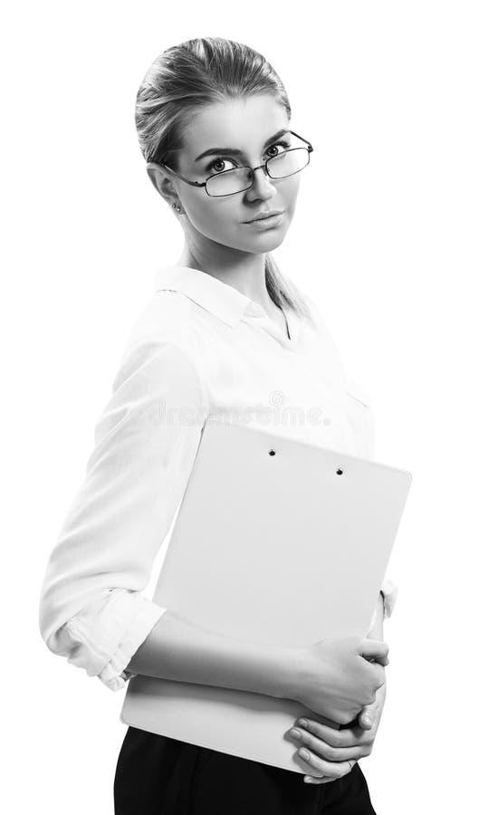 Mujer de negocios rubia joven con la carpeta imagenes de archivo