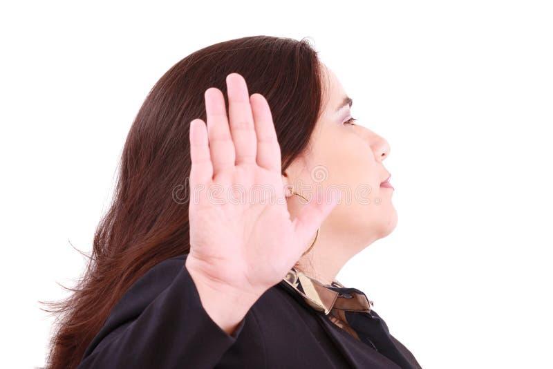 Mujer de negocios seria que hace la muestra de la parada fotos de archivo libres de regalías
