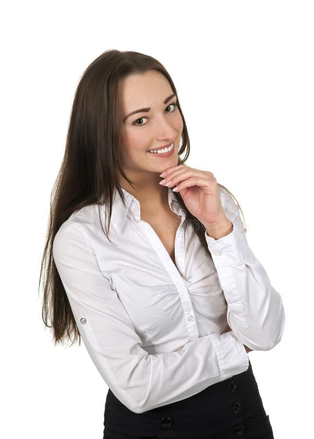 Mujer de negocios sonriente con la mano en la barbilla fotografía de archivo