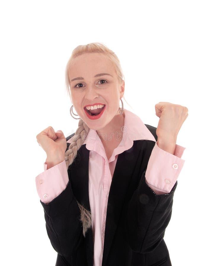 Mujer de negocios sonriente con sus puños imagen de archivo libre de regalías